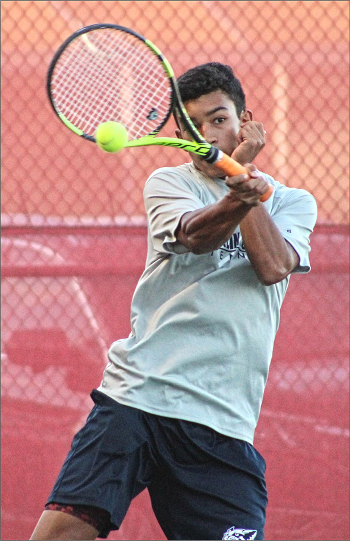 Franklin County senior Kurt Oetzel sizes up a return during No. 1 doubles action Thursday night, Oct. 3, at the Connersville Sectional. Oetzel and his teammate Lonnie Schwartz defeated Connersville's Sebastian Burch and Seth Spurlock 6-4, 5-7, 6-3 to advance to the individual regional.