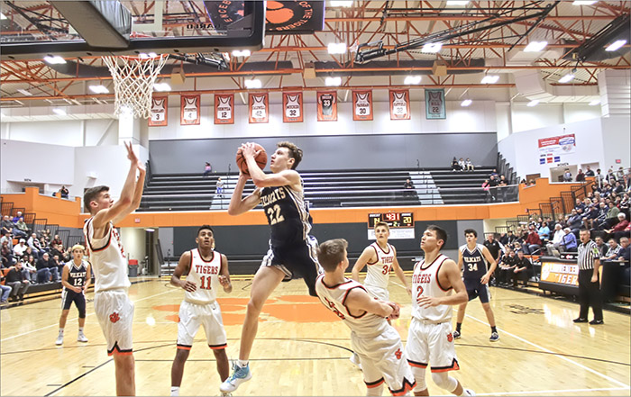 Franklin County sophomore Chad Cox (22) charges through the Lawrenceburg defense for a second quarter layup. Sophomore forward Jackson Bobo (33) attempts a block while Dahya Patel (11), Mitch McCool (5), Ashton Craig (34) and Garrett Yoon (2) round out the defense. Bridger Bolos (12) and JD Stokes (34) watch from outside the three-point line. (John Estridge Photo)